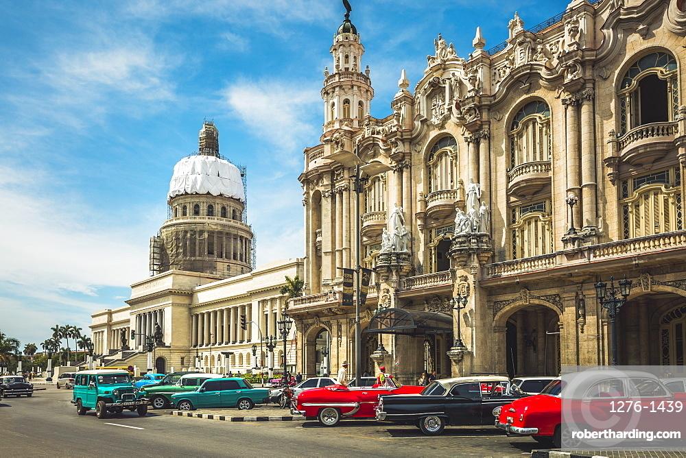 Old American taxi cars parked outside the Gran Teatro de La Habana and El Capitolio, Havana, Cuba, West Indies, Caribbean