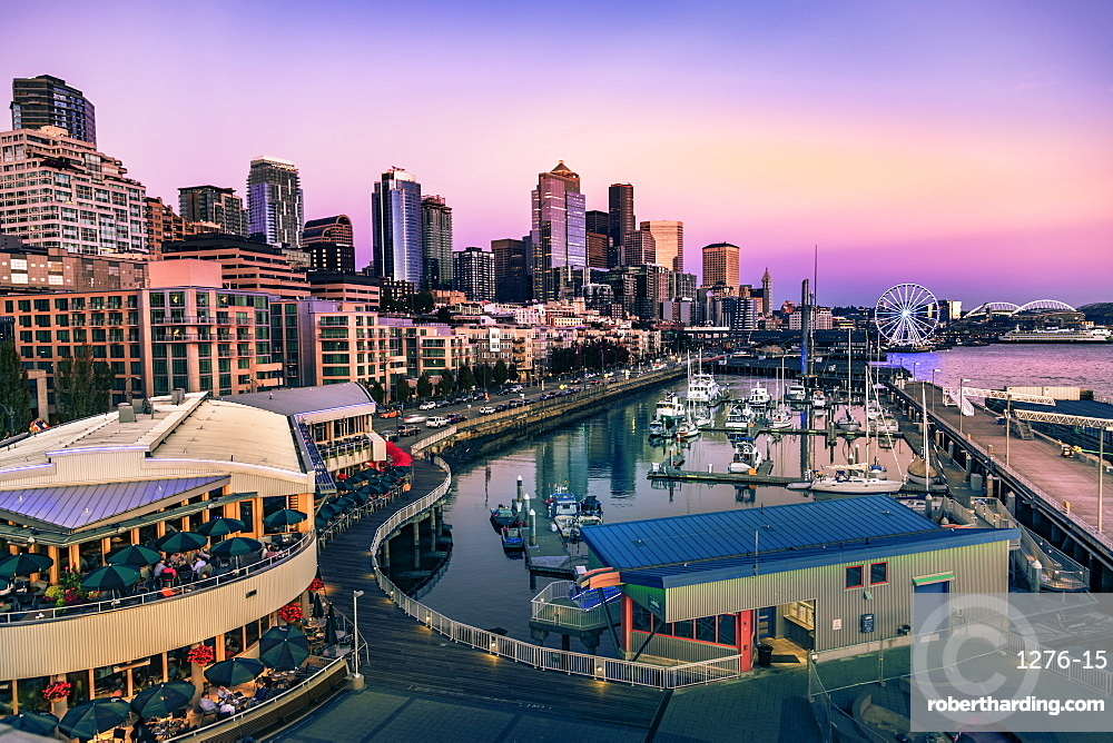 Sunset over Bell Harbor Marina on the Seattle Waterfront with city's skyline in the background. Seattle, Washington, USA