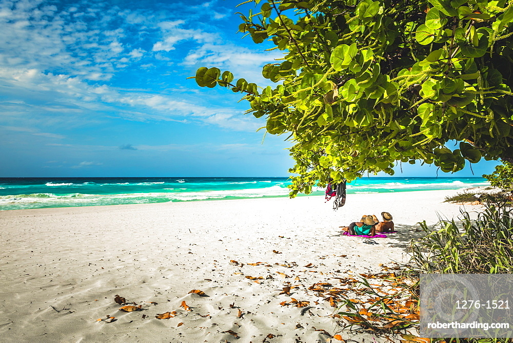 Tourists looking into the sea from Varadero beach, Hicacos Peninsula, Matanzas Province, Cuba, Central America