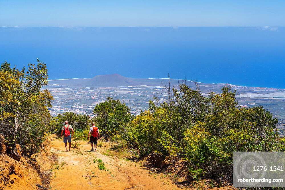 hijers walking down the Las ventanas de Guimar (thousand windows hike) at Tenerife, Canary Islands, Spain, Europe,
