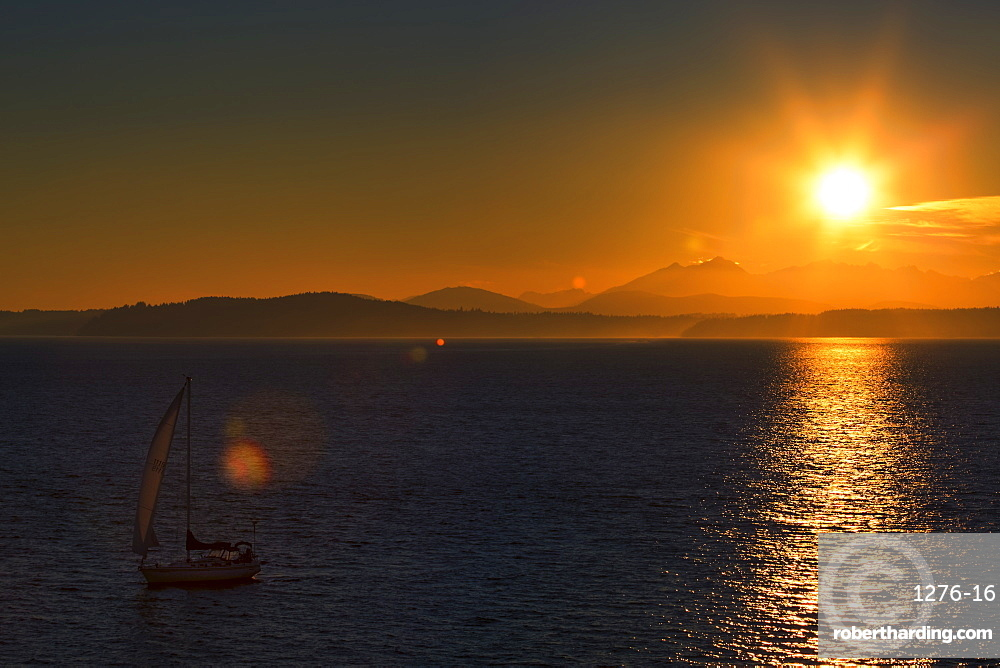 Sunset over Elliot Bay with Olympic Mountains behind, Seattle, Washington, USA