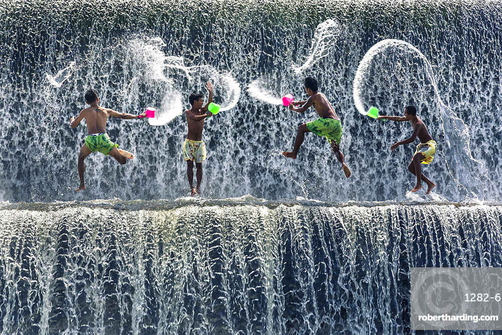 Boys water fight, Tukad Unda dam, Bali, Indonesia, South East Asia.