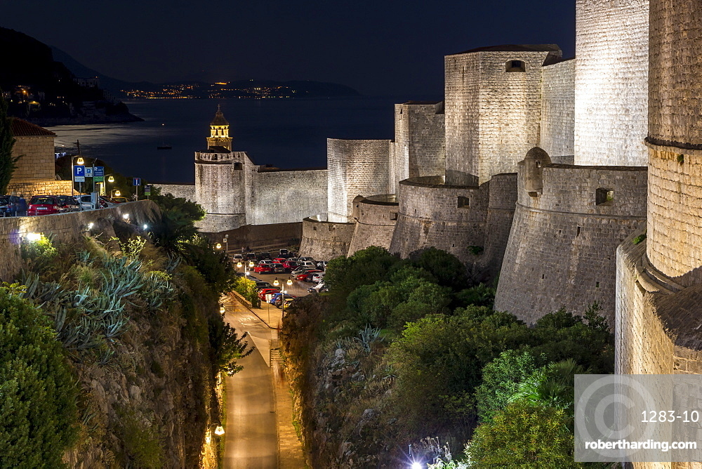 The iluminated city walls of Dubrovnik at night