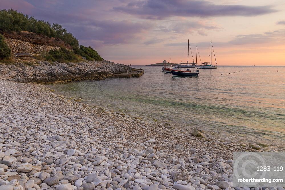 Boats anchoring at Pokonji Dol Beach near Hvar Town at sunset, Hvar, Croatia, Europe