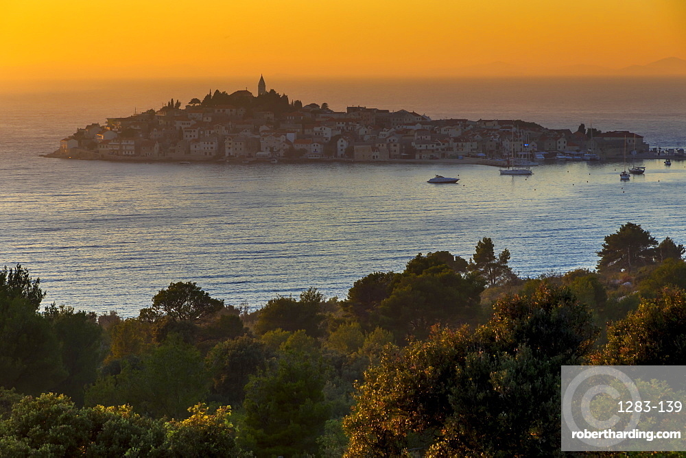 Elevated view over the old town of Primosten, situated on a small island, at sunset, Croatia, Europe