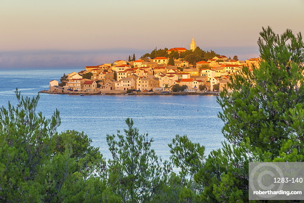 Elevated view over the old town of Primosten, situated on a small island, at sunrise, Croatia, Europe