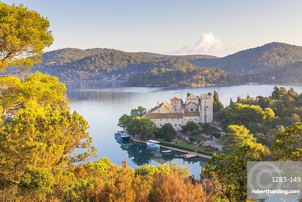 Elevated view over Veliko Jezero (Big Lake) and the monastery on Saint Mary Island inside Mljet National Park, Croatia, Europe