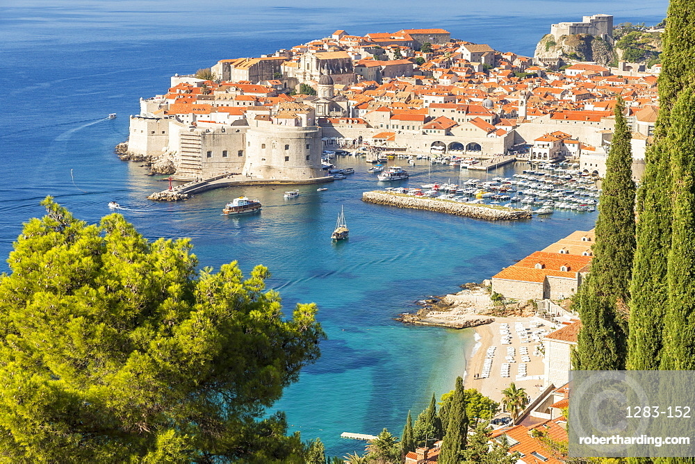 High-angle view over the old town of Dubrovnik and Banje Beach, Dubrovnik, Croatia, Europe