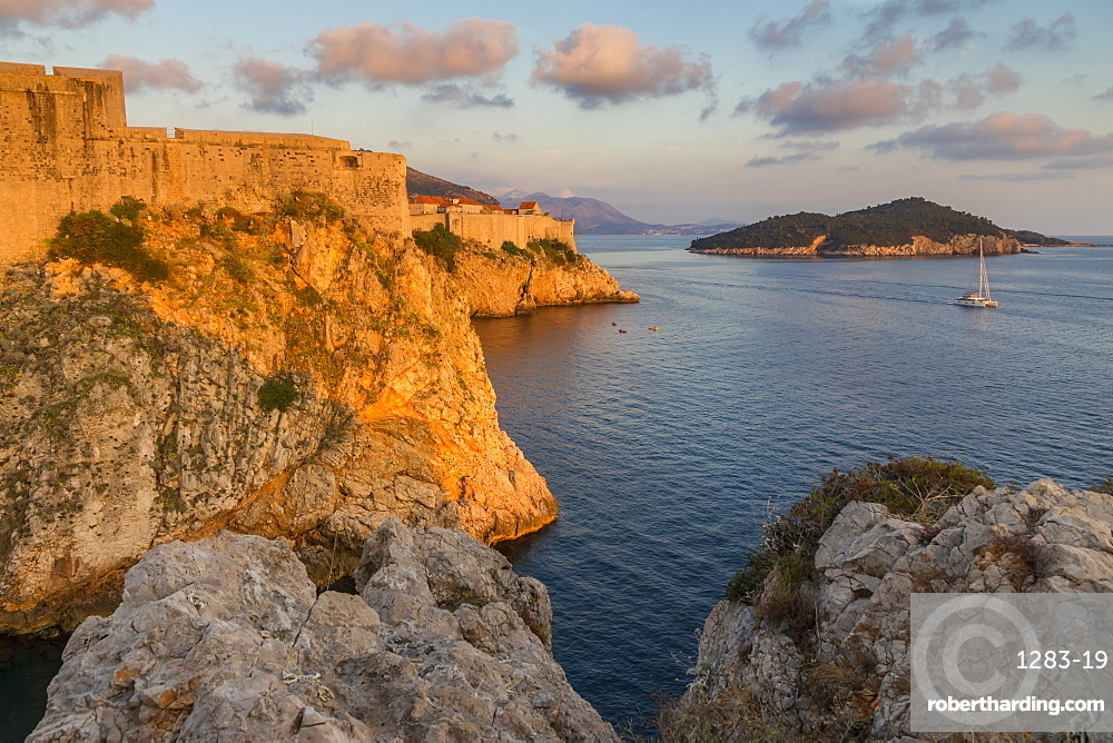 View to Lovrijenac Fortress (St. Lawrence Fortress), the city walls and Lokrum Island at sunset, Croatia, Europe