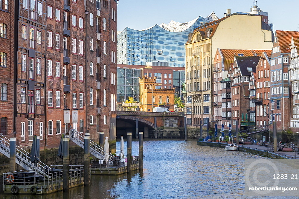 Historical buildings at Nikolaifleet with view to the Elbphilharmonie building in the background at first sunlight, Hamburg, Germany, Europe