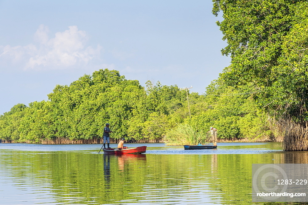 Fishermen in their boats at the mangroves near Monterrico, Guatemala, Central America