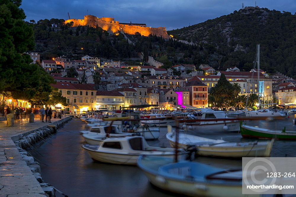 The port of Hvar Town and the Spanish Fortress at dusk, Hvar, Croatia, Europe