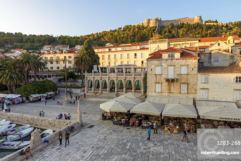 Elevated view over the main square (Trg Svetog Stjepana) and the Spanish Fortress in Hvar Town at first sunlight, Hvar, Croatia, Europe