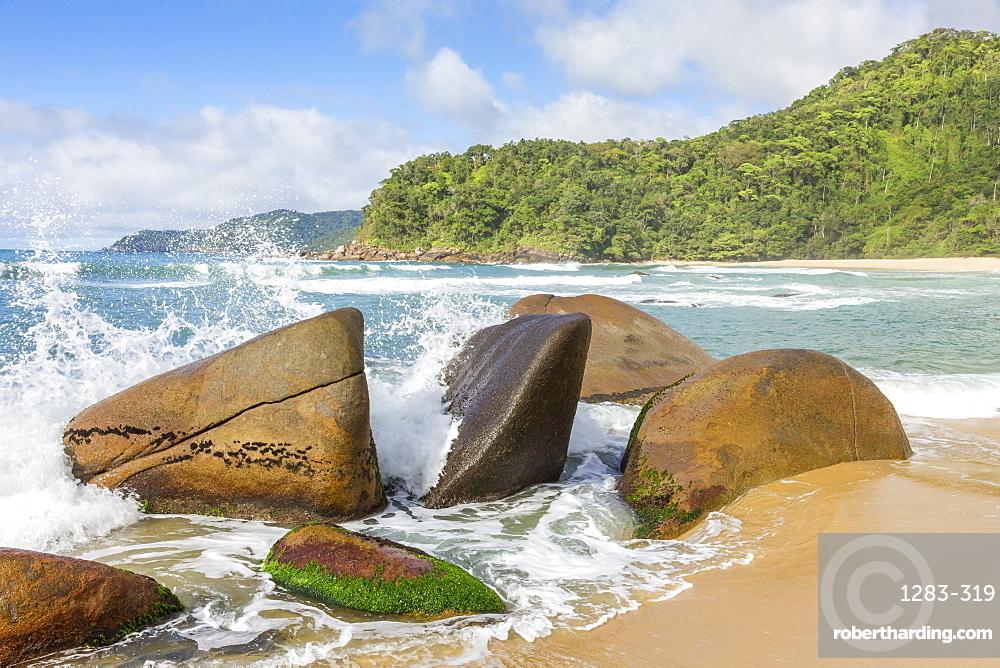 Waves splashing against rocks, Antigo Beach, Paraty (Parati), Rio de Janeiro, Brazil, South America