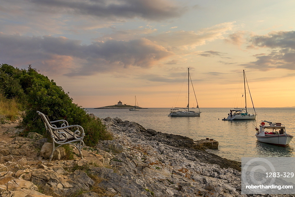 Boat anchoring at Pokonji Dol Beach near Hvar Town at sunset, Hvar, Croatia, Europe