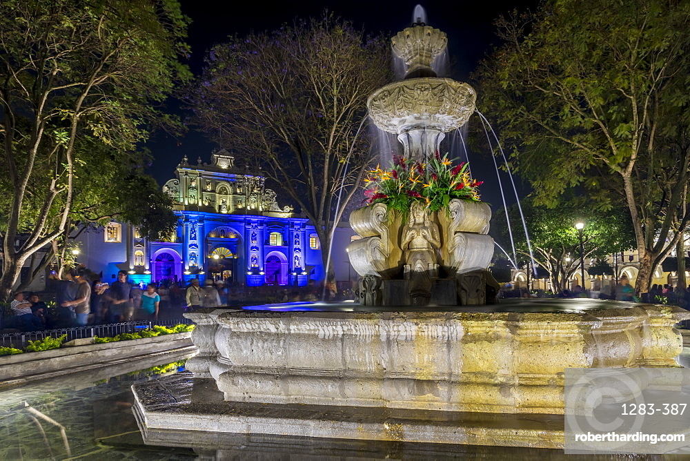 The fountain at the main square with view to the San Jose Cathedral during Holy Week, Antigua, Sacatepequez, Guatemala, Central America