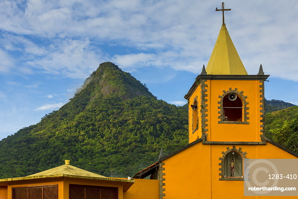 The Church of San Sebastian and the Parrot Peak (Pico do Papagaio), Vila do Abraao, Ilha Grande, Rio de Janeiro, Brazil, South America