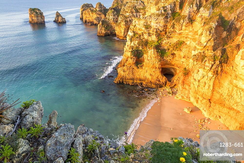 Secluded beach near Ponta da Piedade at first sunlight, Lagos, Algarve, Portugal, Europe