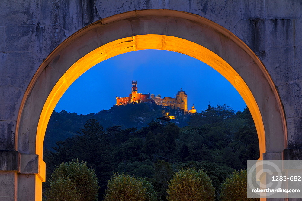 Illuminated Pena Palace seen from the Seteais Palace at dusk, UNESCO World Heritage Site, Sintra, Portugal, Europe