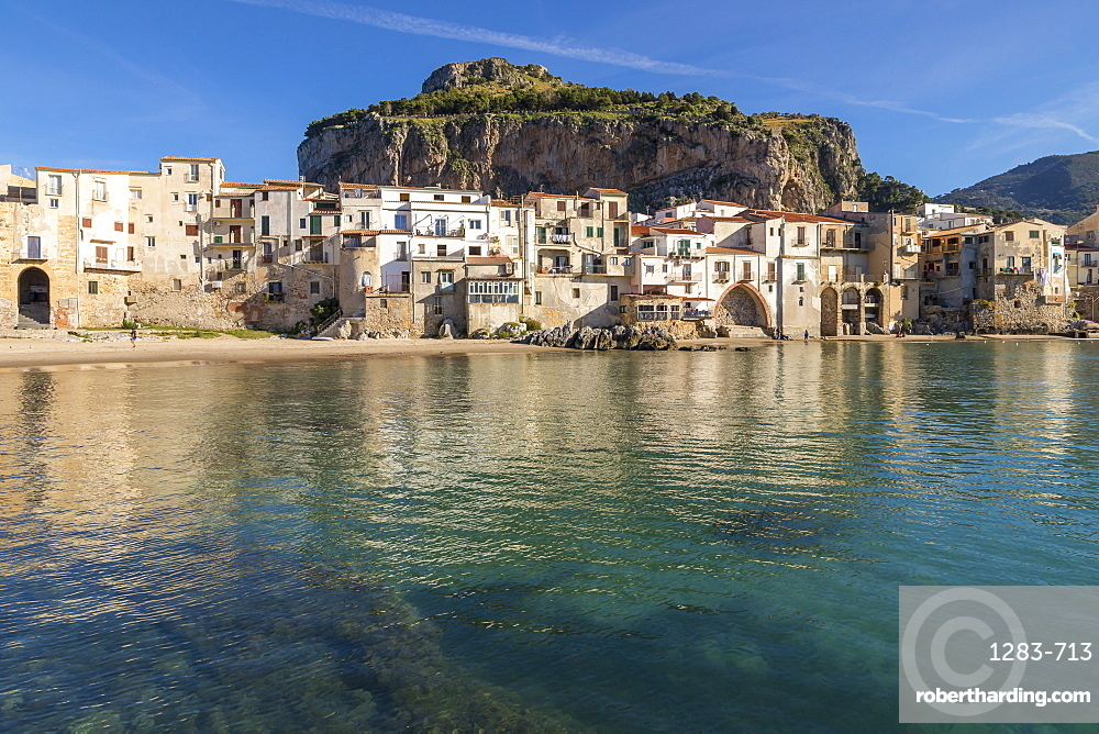 The old town of Cefalu with Rocca di Cefalu in the background, Cefalu, Sicily, Italy, Europe