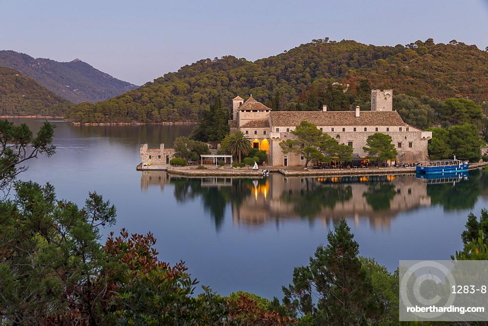 Monastery of Saint Mary at Veliko Jezero (Big Lake) on Mljet Island at dusk, Croatia, Europe
