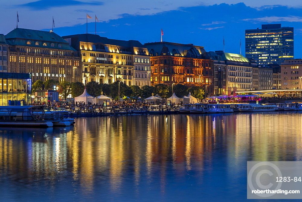 Illuminated buildings at Jungfernstieg and the Inner Alster at dusk, Hamburg, Germany, Europe