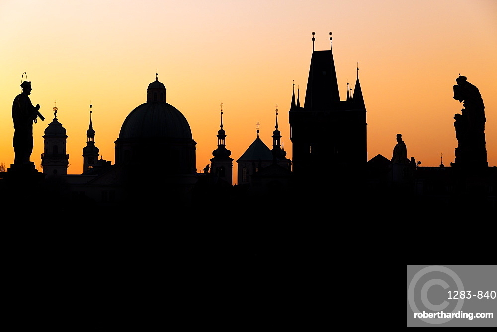 Silhouette of the old town buildings seen from Charles Bridge at sunrise, Prague, Bohemia, Czech Republic, Europe