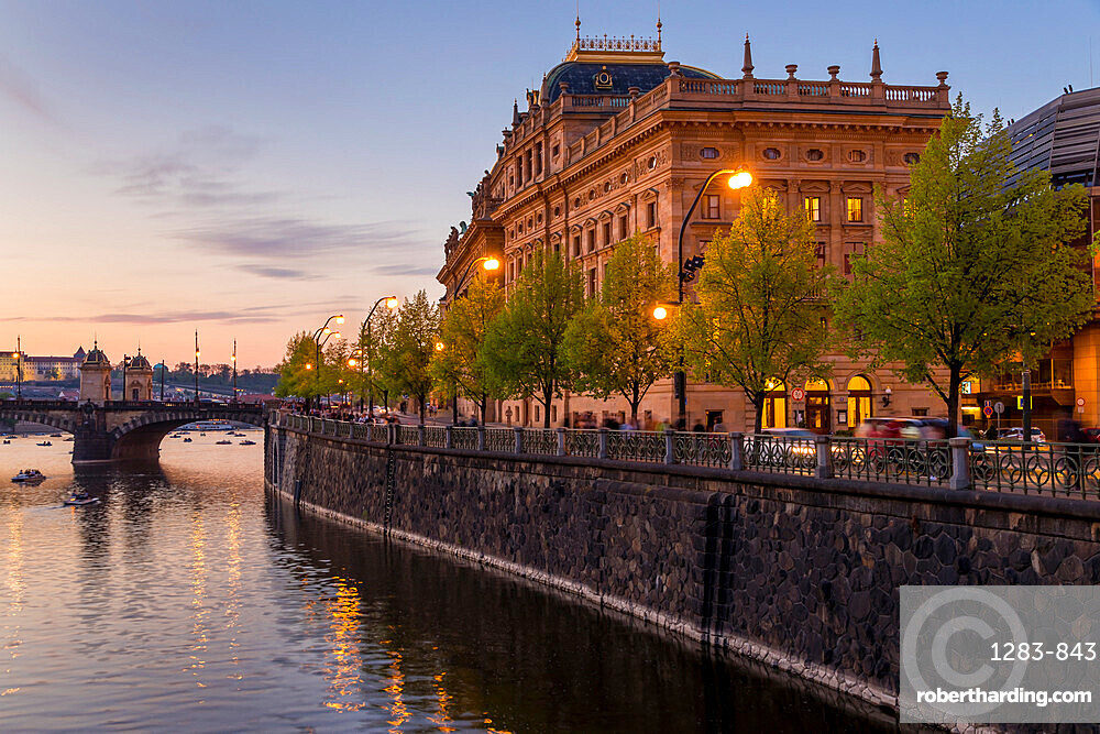 The National Theatre (Narodní divadlo) seen from the banks of Vltava River at dusk, Prague, Bohemia, Czech Republic, Europe