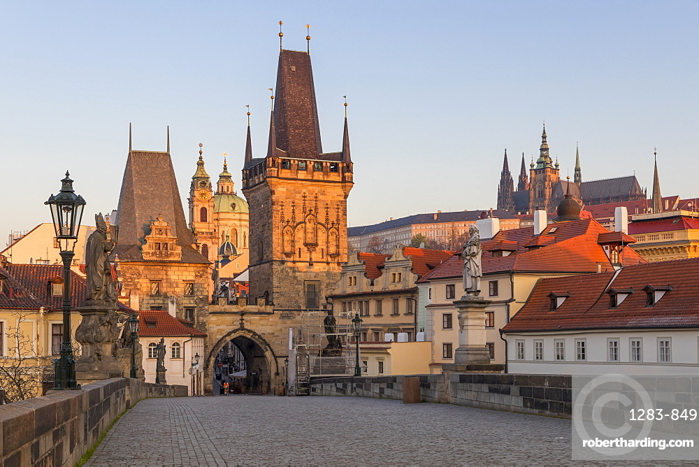 The Lesser Town Bridge Tower and St. Vitus Cathedral seen from Charles Bridge at first sunlight, Prague, Bohemia, Czech Republic