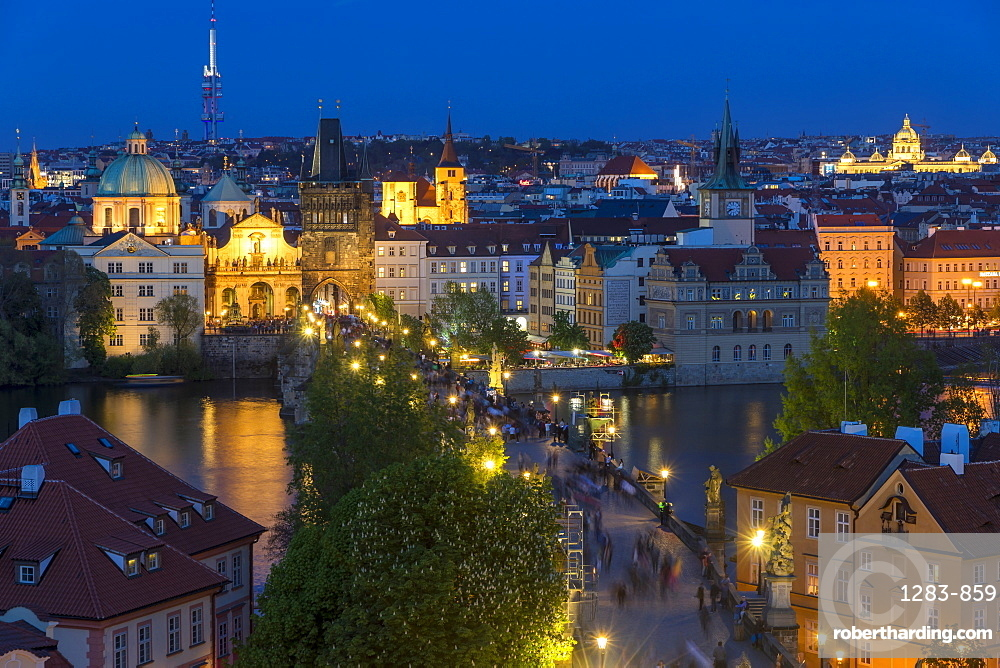 View from the Mala Strana Bridge Tower over Charles Bridge and the old town at dusk, Prague, Bohemia, Czech Republic, Europe