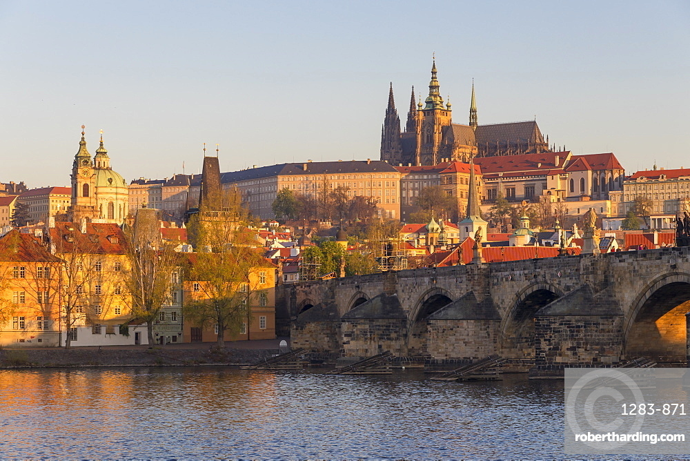 View from the banks of Vltava River to Charles Bridge, Prague Castle and St. Vitus Cathedral, Prague, Bohemia, Czech Republic
