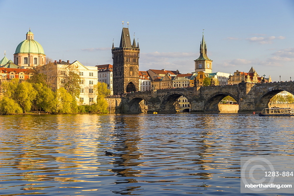 Charles Bridge and the Old Town Bridge Tower seen from the banks of Vltava River, Prague, Bohemia, Czech Republic, Europe
