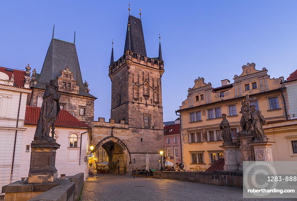 The Lesser Town Bridge Tower seen from Charles Bridge at dawn, Prague, Bohemia, Czech Republic, Europe