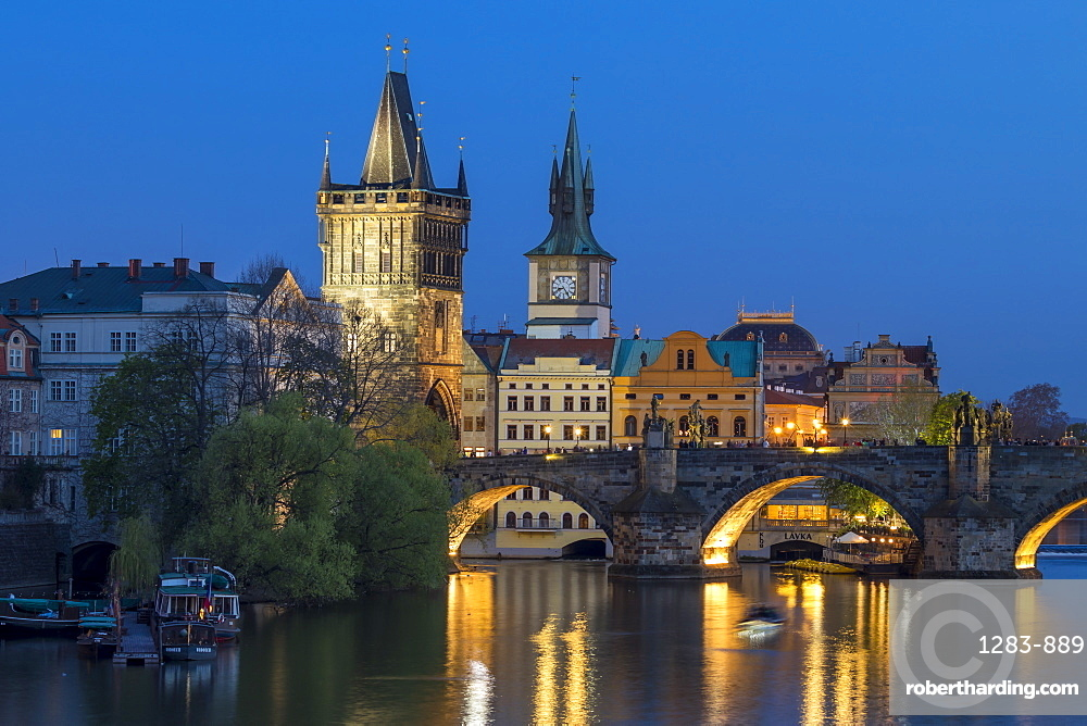 View over Charles Bridge, Old Town Bridge Tower and Vltava River at dusk, Prague, Bohemia, Czech Republic, Europe
