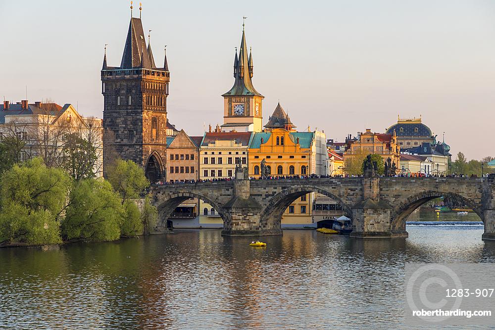 View over Charles Bridge, Old Town Bridge Tower and Vltava River at last sunlight, Prague, Bohemia, Czech Republic, Europe
