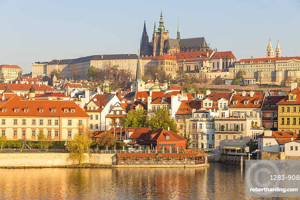 View from the banks of Vltava River over the Mala Strana district, Prague Castle and St. Vitus Cathedral, Prague, Czech Republic