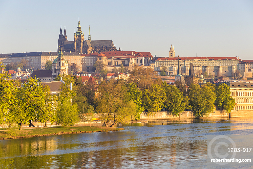 Prague Castle and St. Vitus Cathedral seen from the banks of Vltava River at first sunlight, UNESCO World Heritage Site, Prague, Bohemia, Czech Republic