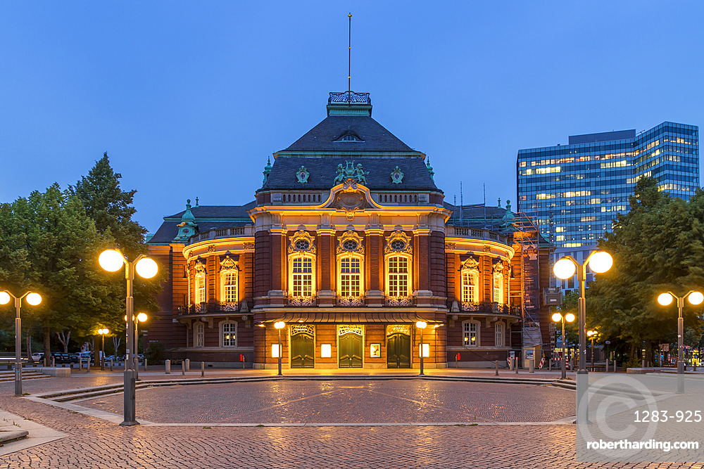 The illuminated Laeiszhalle concert hall at Johannes Brahms Square during dusk, Hamburg, Germany, Europe