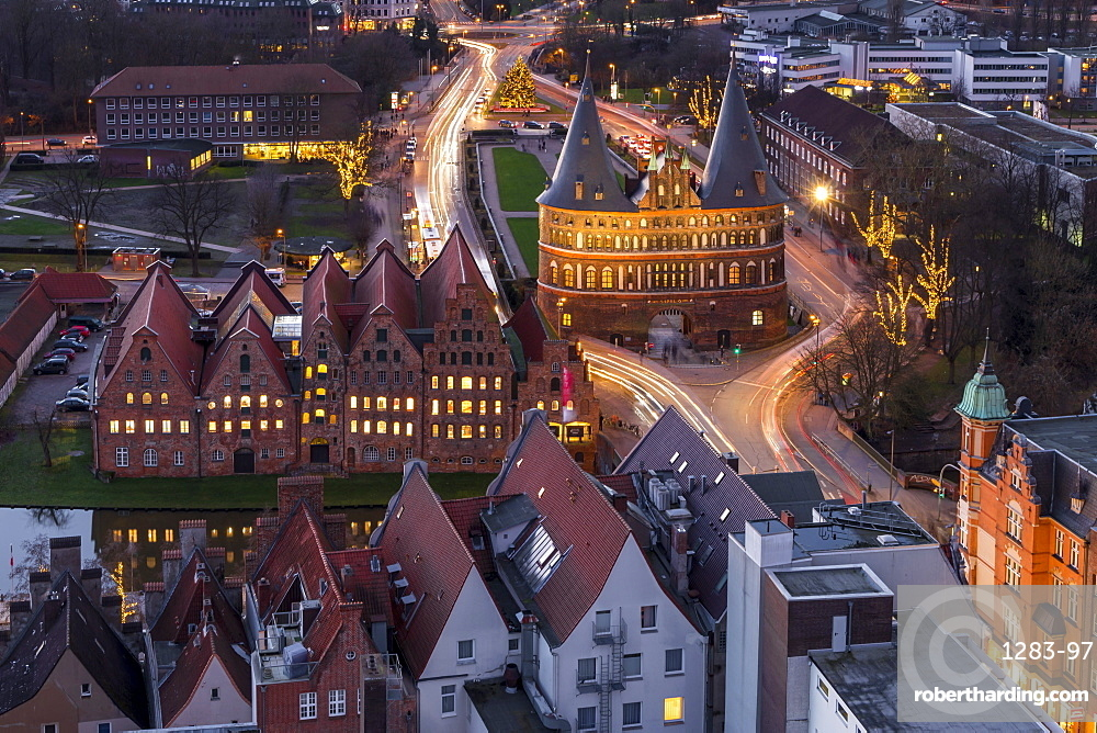 Elevated view from the St. Petri Church over the Holsten Gate in Lubeck at dusk, Lubeck, Schleswig-Holstein, Germany, Europe