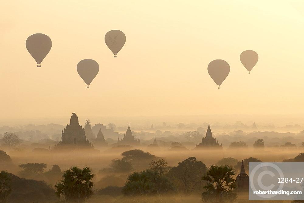 Hot air ballons fly over ancient temples at dawn in Bagan (Pagan), Myanmar (Burma), Asia