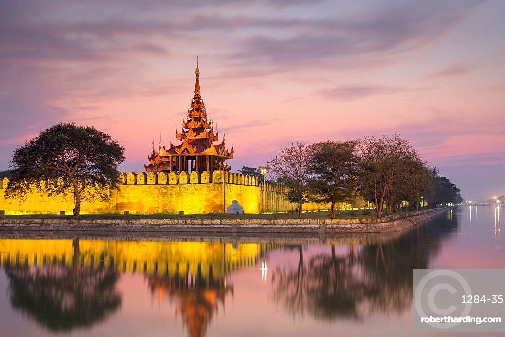 Sunset view of the Royal Palace, City Moat and City Wall in Mandalay, Myanmar (Burma)