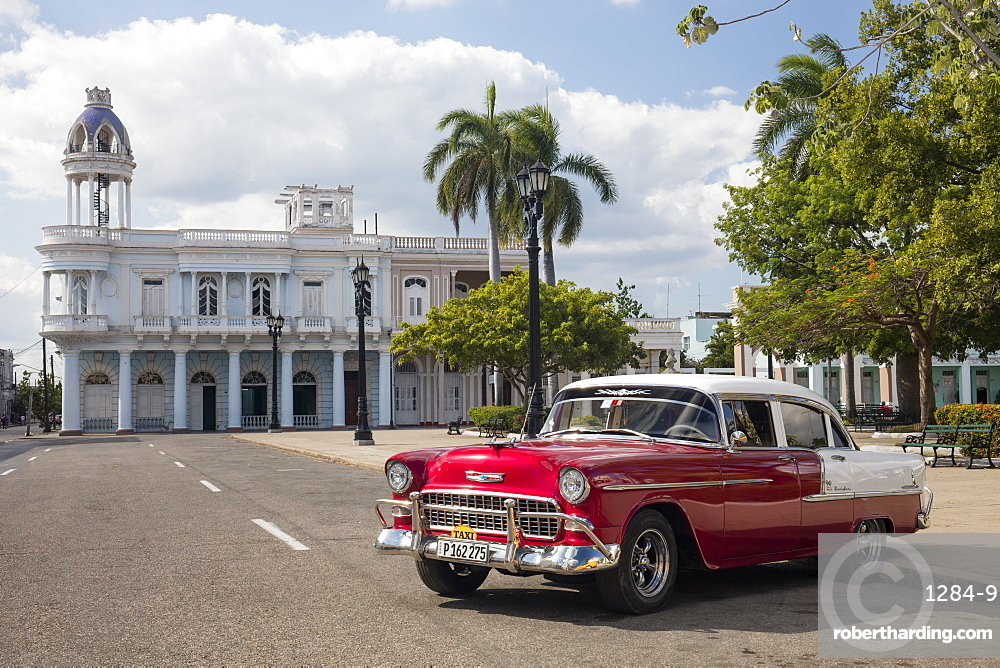 Red Chevrolet Bel Air parked in Cienfuegos town square, Cuba