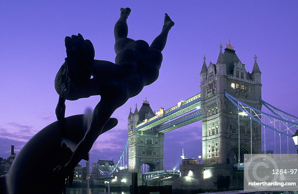 Girl with Dolphin fountain and Tower Bridge at dawn, London, England, United Kingdom, Europe