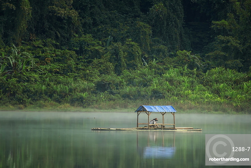 Boatman waiting in the middle of the lake at situgunung lake. west java