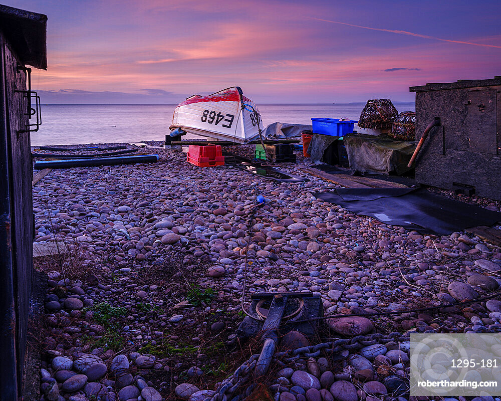 Turning block and boat on the pebbled beach at Budliegh Salterton, Devon, UK