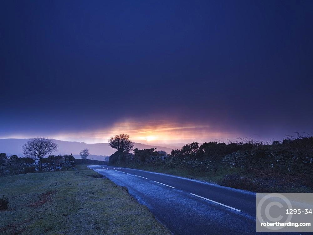 Moody winter sunrise in a hail shower at Bel Tor Corner, Dartmoor National Park, Ashburton, Devon, England, United Kingdom, Europe