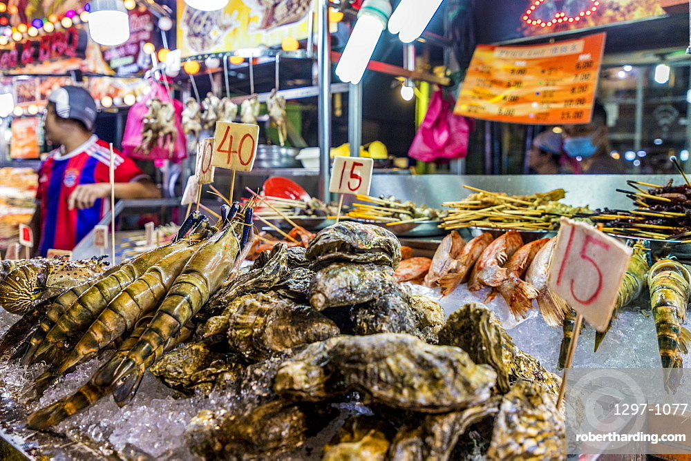 Fresh fish market stall at Jalan Alor Night Food Market in Kuala Lumpur, Malaysia, Southeast Asia, Asia