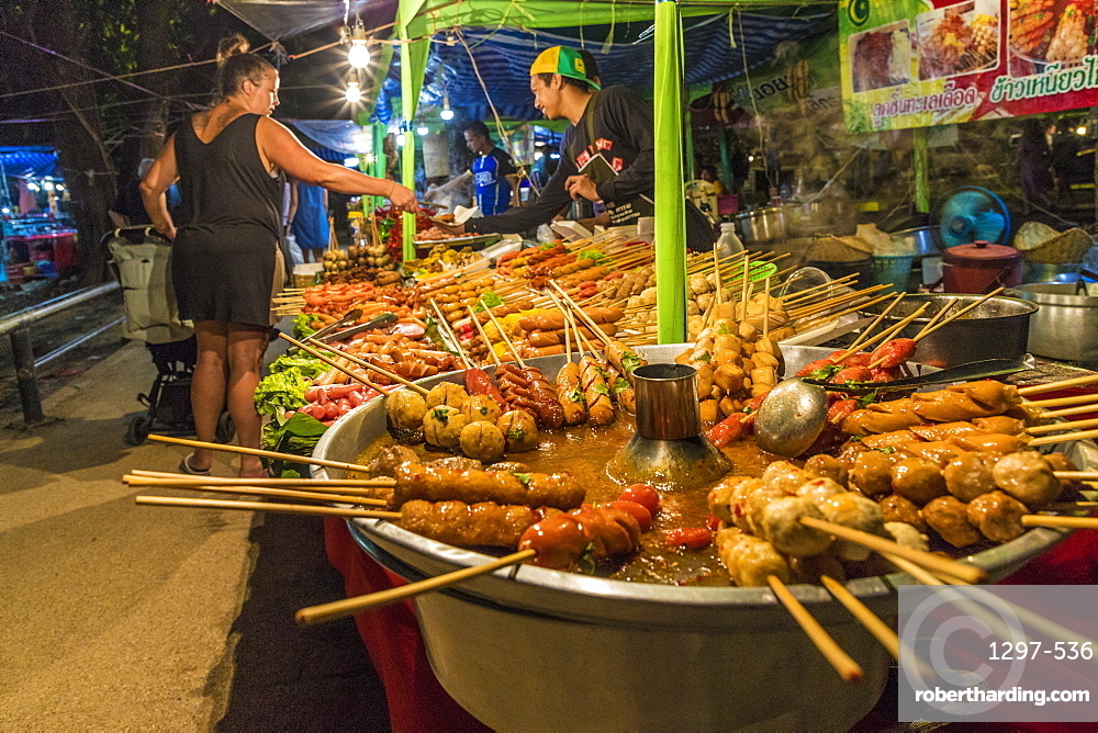 Grilled meats for sale at a food stall at Kamala night market in Phuket, Thailand, Southeast Asia, Asia.