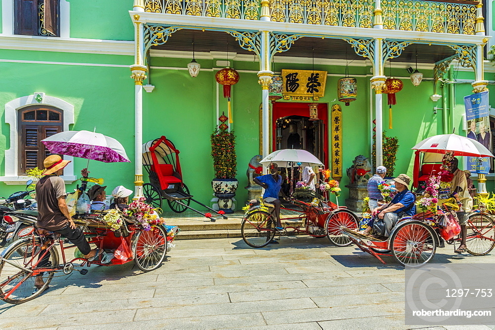 Tourists outside the Pinang Peranakan Mansion in George Town, Penang Island, Malaysia, Southeast Asia, Asia