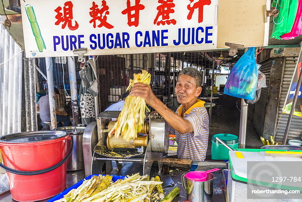 A pure sugar cane juice stall in George Town ,Penang Island, Malaysia, Southeast Asia, Asia.